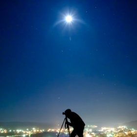 Photographer under the moon